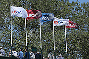 June 12 2013: Flags of the USGA fly on top of the grandstand on 18 during the wednesday practice round at the 2013 U.S. Open hosted by Merion Golf Club in Ardmore, PA.