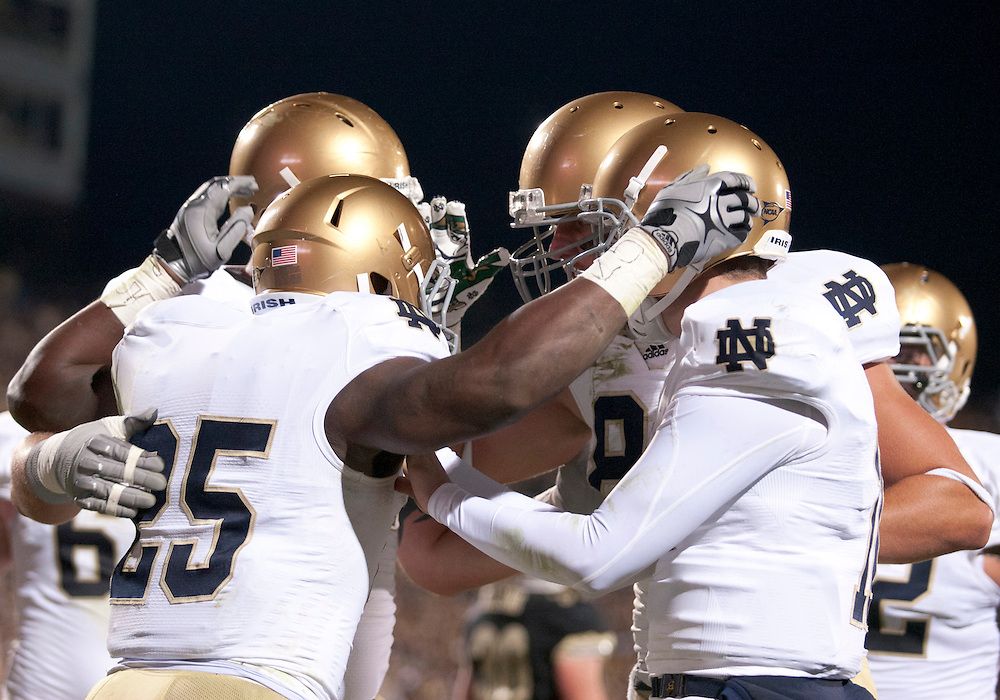 October 01, 2011:  Notre Dame players celebrate touchdown by tailback Jonas Gray (#25) during NCAA Football game action between the Notre Dame Fighting Irish and the Purdue Boilermakers at Ross-Ade Stadium in West Lafayette, Indiana.  Notre Dame defeated Purdue 38-10.