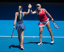 MELBOURNE, Jan. 24, 2018  Timea Babos (R) of Hungary and Kristina Mladenovic of France celebrate during the women's doubles semifinal against Peng Shuai of China and Hsieh Su-Wei of Chinese Taipei at Australian Open 2018 in Melbourne, Australia, Jan. 24, 2018. Timea Babos and Kristina Mladenovic won 2-0 to enter the final. (Credit Image: © Zhu Hongye/Xinhua via ZUMA Wire)