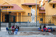 Sellers sit in front of a church along Hai Ba Trung Street in Hanoi, Vietnam, Southeast Asia