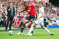 Football - 2017 / 2018 Premier League - Swansea City vs. Manchester United<br /> <br /> Antonio Valencia of Manchester United attacks Tom Carroll of Swansea City—<br /> , at Liberty Stadium.<br /> <br /> COLORSPORT/WINSTON BYNORTH