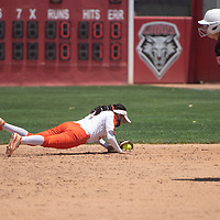 Gallup Bengals second baseman Katherine Lincoln dives for a ball after she makes a play diving for the ball and throwing a batter out at first base to end the inning during their NMAA Class 4A Softball State Championship game against the Artesia Bulldogs Saturday in Albuquerque.
