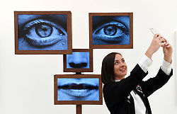 Review of the Year 2017: March: A visitor takes a selfie in front of an installation during a press preview at the Selfie to Self-Expression exhibition at the Saatchi Gallery in London, which looks at the history of the selfie from portrait artists through to modern day selfies.