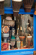 Wooden musical instruments for sale at a shop in the medina of Essaouira in Morocco