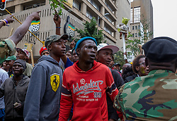 JOHANNESBURG, April 7, 2017  Supporters of South African President Jacob Zuma gather outside the Luthuli House in Johannesburg,?South?Africa, on April 7, 2017.?South Africans on Friday marched across the country calling for President Jacob Zuma to step down while his supporters also marched in solidarity with him. (Credit Image: © Yeshiel Panchia/Xinhua via ZUMA Wire)