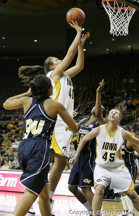 28 NOVEMBER 2007: Iowa center Stacy Schlapkohl (40) puts up a shot while Georgia Tech guard Iasia Hemingway (34) and Iowa center JoAnn Hamlin (45) look on in the first half of Georgia Tech's 76-57 win over Iowa in the Big Ten/ACC Challenge at Carver-Hawkeye Arena in Iowa City, Iowa on November 28, 2007.