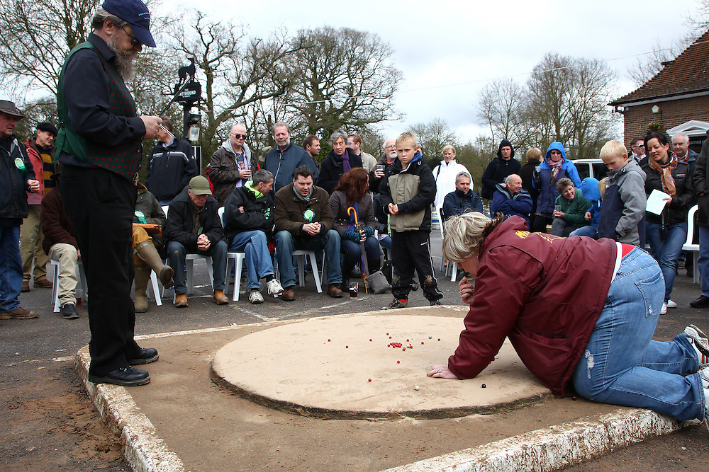 Tinsley Green, Crawley - Friday April 2nd, 2010: Debra Stanley-Lapic, former American National Marbles Champion, takes a shot during the World Marble Championships at the The Greyhound, Tinsley Green, Crawley. (Pic by Andrew Tobin/Focus Images)