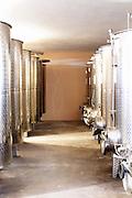 Stainless steel fermentation and storage tanks in the underground cellar. Kantina Miqesia or Medaur winery, Koplik. Albania, Balkan, Europe.