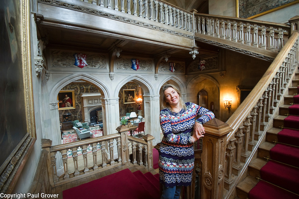 Dow0034269.DT Weekend.Lady Fiona Carnarvon the Red Staircase at her home Highclere Castle