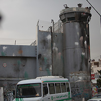 The Israeli West Bank barrier or wall is a separation barrier in the West Bank. Israel calls it a security barrier while Palestinians and many others call it a racial segregation or apartheid wall. At a total length of 708 kilometres (440 miles) upon completion, the border traced by the barrier is more than double the length of the Green Line, with 15% running along it or in Israel, while the remaining 85% cuts at times 18 kilometres (11 miles) deep into the West Bank, isolating about 9.4% of it, leaving an estimated 25,000 Palestinians isolated from the bulk of that territory.