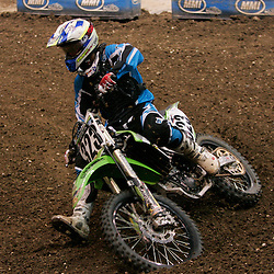 14 March 2009: James Povolny (323) rides in a qualifying heat during the Monster Energy AMA Supercross race at the Louisiana Superdome in New Orleans, Louisiana