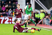 Correction: John Souttar (#4) of Heart of Midlothian slides in on Marvin Bartley (#6) of Hibernian during the William Hill Scottish Cup 4th round match between Heart of Midlothian and Hibernian at Tynecastle Stadium, Gorgie, Scotland on 21 January 2018. Photo by Craig Doyle.