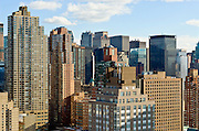View of Midtown West Manhattan skyline with office buildings and apartment buildings, New York City.