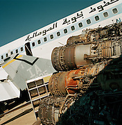 Airliner and jet engines in mid-day heat of arid Sonoran Desert at Mojave airport facility, awaiting recycling for scrap value.