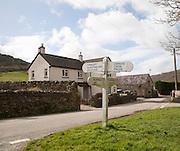 Road sign on village green at Brendon, Exmoor national park, Devon, England