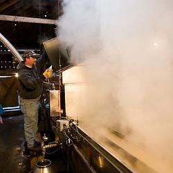 Ralph Luce tending the sap evaporator in his sugar house  at Sugarbush Farm in Woodstock, Vermont.