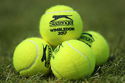 Slazenger tennis balls on day four of the Wimbledon Championships at the All England Lawn Tennis and Croquet Club, Wimbledon. PRESS ASSOCIATION Photo. Picture date: Thursday July 6, 2017. See PA story TENNIS Wimbledon. Photo credit should read: Philip Toscano/PA Wire. RESTRICTIONS: Editorial use only. No commercial use without prior written consent of the AELTC. Still image use only - no moving images to emulate broadcast. No superimposing or removal of sponsor/ad logos.