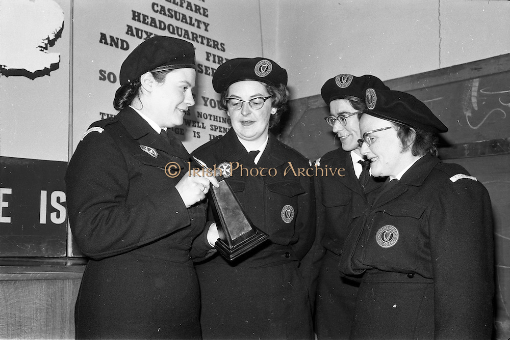 31/03/1963<br /> 03/31/1963<br /> 31 March 1963<br /> Civil Defence Competitions at Jervis Street Hospital, Dublin sponsored by W.D. & H.O. Wills Ltd., for the Gold Flake Trophy. Miss Frances Todd, (left) Leader of the winning Dublin Area 3 (Rathmines) team in the Civil Defence Casualty Section Competitions showing the trophy to her team, Miss Carmel Doyle; Miss Eithne McManus and Mrs F. Brierton.