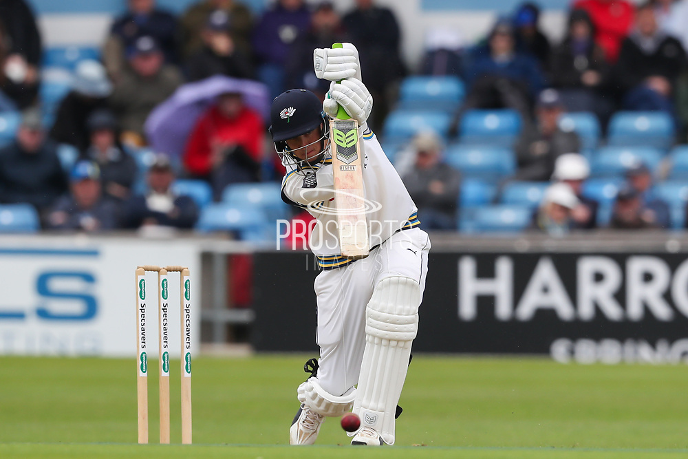 Tom Kohler-Cadmore of Yorkshire place a defensive shot  during the opening day of the Specsavers County Champ Div 1 match between Yorkshire County Cricket Club and Hampshire County Cricket Club at Headingley Stadium, Headingley, United Kingdom on 27 May 2019.