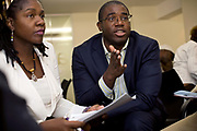 David Lammy, Member of Parliament for Tottenham and Minister for Skills, takes part in a group discussion about gang culture at a seminar in South London