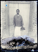 eroding glass plate photo of young African boy holding a basket