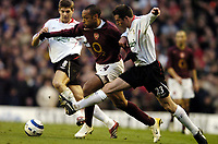 Photo: Olly Greenwood.<br />Arsenal v Liverpool. The Barclays Premiership. 12/03/2006. Arsenal's Thierry Henry gets past Liverpool's Jamie Carragher
