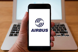 Using iPhone smartphone to display logo of Airbus aviation company