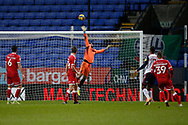 Crawley Town's Glenn Morris watches a shot from Bolton Wanderers Nathan Delfouneso(7) go over the bar during the EFL Sky Bet League 2 match between Bolton Wanderers and Crawley Town at the University of  Bolton Stadium, Bolton, England on 2 January 2021.