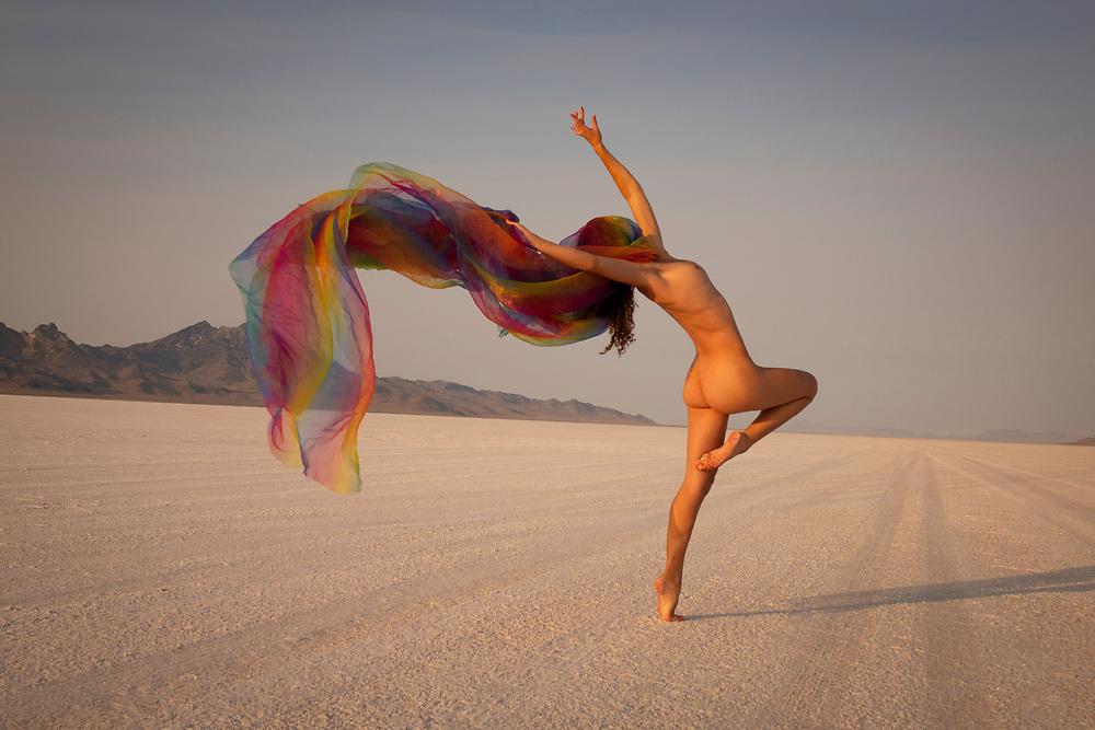 Nude woman dancing and waving a long scarf at the Bonneville Salt Flats, Utah