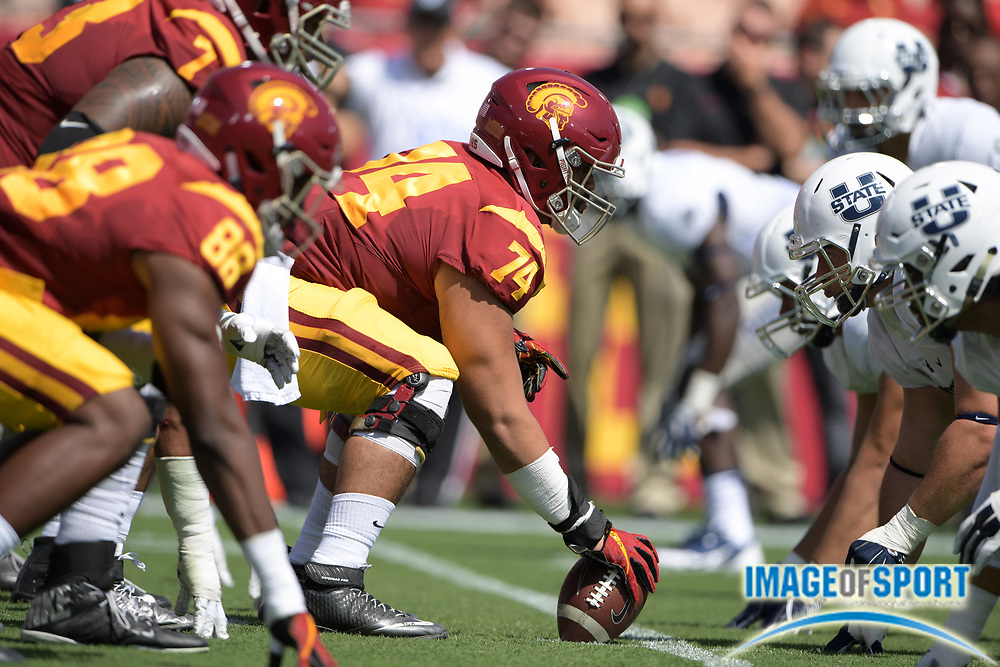 Sep 10, 2016; Los Angeles, CA, USA; General view of the line of scrimmage as USC Trojans center Nico Falah (74) snaps the ball against the Utah State Aggies during a NCAA football game at Los Angeles Memorial Coliseum.