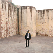 A gentleman wearing a suit at the Mehrangarh or Mehran Fort, one of the largest forts in India. Jodhpur is known as the Blue City.