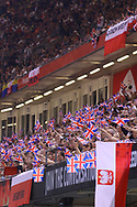 British flags waved by fans during the 2019 Adrian Flux British FIM Speedway Grand Prix at the Principality Stadium, Cardiff, Wales on 21 September 2019.