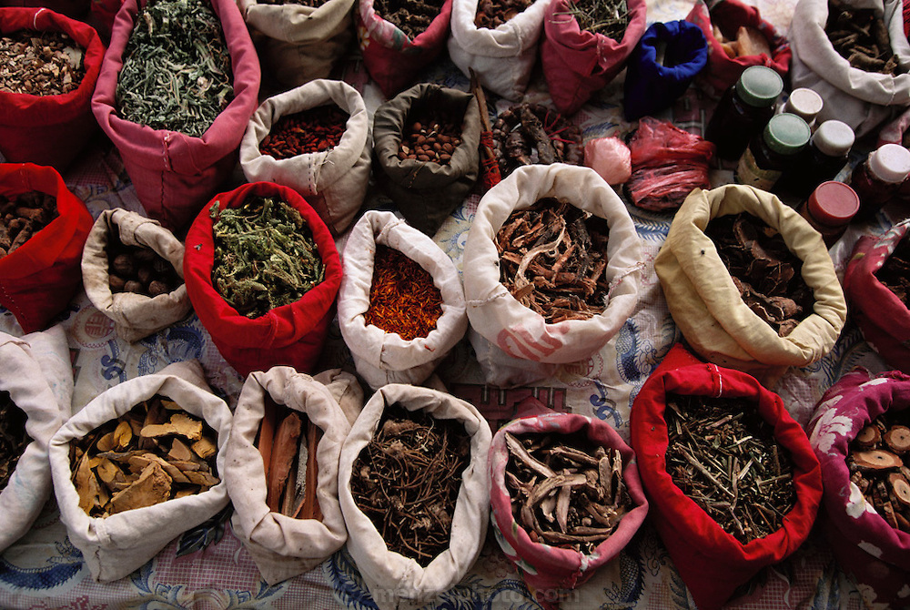 Herbs used by folk medicine doctor. Menghan Sunday market in Xishaungbanna, China.