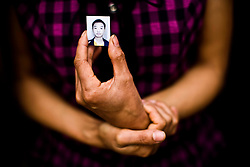 Mother holds a picture of her son during the memorial service for children who were killed by the building collapse at Juyuan Middle School in Dujiangyan county, Sichuan province in China.