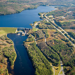 The Moore Dam and Moore Reservoir on the Connecticut River in Littleton, New Hampshire.  White Mountains are in the distance.  Interstate 93 parallels the river.