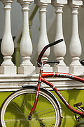 Red bicycle leaning against a balustrade, Little Corn Island, Nicaragua