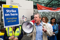 London, UK. 15 July, 2019. Mark Serwotka, General Secretary of the Public & Commercial Services Union (PCS), addresses catering and cleaning staff outsourced to work at the Department for Business, Energy and Industrial Strategy (BEIS) via contractors ISS World and Aramark on the picket line outside the Government department after walking out on an indefinite strike for the London Living Wage, terms and conditions comparable to the civil servants they work alongside and an end to outsourcing.