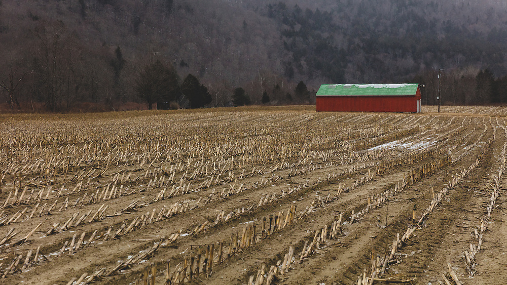 A frozen winter farm in the foothills of Vermont's Green Mountains.