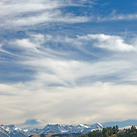 Cirrus clouds over the Absaroka Mountains and Paradise Valley, as viewed from Trail Pass, near Bozeman, Montana.