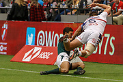 VANCOUVER, BC - MARCH 11: Muller du Plessis (#5) of South Africa tosses Brett Thompson (#5) of USA into touch during Game # 44- South Africa vs Usa Bronze Medal Match match at the Canada Sevens held March 11, 2018 in BC Place Stadium in Vancouver, BC. (Photo by Allan Hamilton/Icon Sportswire)