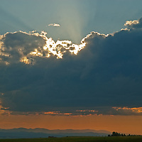 Sunlit clouds hover over Montana's Gallatin Valley.