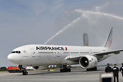 A water cannon is sprayed on the French team's Air France plane on its arrival at the Roissy-Charles de Gaulle airport on the outskirts of Paris, France, on July 16, 2018 after winning the Russia 2018 World Cup final football match. Photo by ABACAPRESS.COM