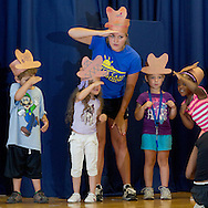 """Middletown, New York -  Children and a counselor from the Middletown YMCA's Camp Funshine perform in """"The Show"""", a musical production, on Aug. 7, 2014."""