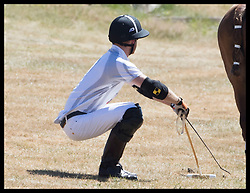 June 30, 2018 - Ascot, United Kingdom - Image licensed to i-Images Picture Agency. 30/06/2018. Ascot, United Kingdom. Prince Harry does a warm up exercise before taking part in the Audi Polo Challenge at Coworth Park Polo Club near Ascot,United Kingdom. (Credit Image: © Stephen Lock/i-Images via ZUMA Press)