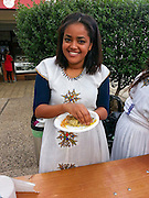 Young Ethiopian Jew in traditional dress and a plate of Ethiopian food