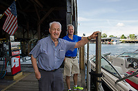 Jack and Bill Irwin at the gas docks at Irwin Marine on Lake Winnipesaukee in Laconia.  (Karen Bobotas for New England Boating Magazine)