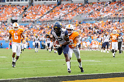Sep 1, 2018; Charlotte, NC, USA; West Virginia Mountaineers wide receiver Gary Jennings Jr. (12) catches a touchdown pass during the third quarter against the Tennessee Volunteers at Bank of America Stadium. Mandatory Credit: Ben Queen-USA TODAY Sports