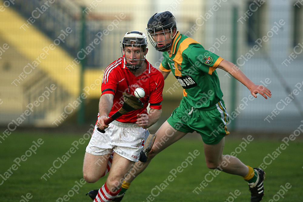 Crusheen's Alan Brigdale and O' Callaghans Mills Adrian Flaherty in action during the Senior B hurling final in Clarecastle on Sunday afternoon.<br /> Photograph by Yvonne Vaughan
