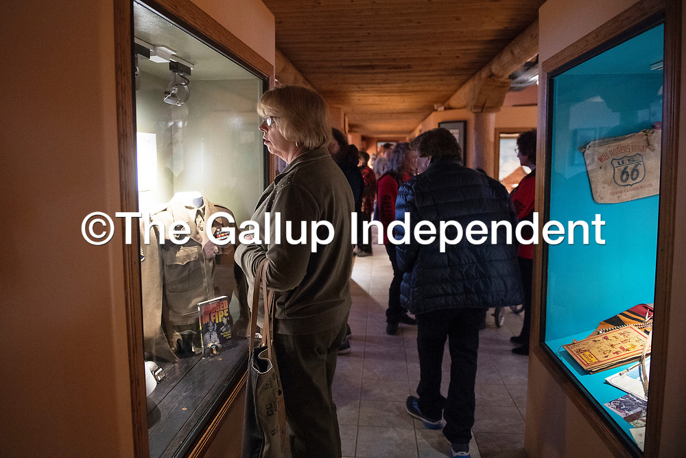 Linda Mattia views the Hershey Miyamura exhibit case as part of the new Navajo Code Talker exhibit during the reopening of the Gallup Cultural Center Thursday, March 5 in Gallup.