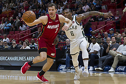 January 14, 2018 - Miami, FL, USA - Miami Heat guard Goran Dragic (7) fights for possession against Milwaukee Bucks' Eric Bledsoe (6) in the first quarter on Sunday, Jan. 14, 2018 at the AmericanAirlines Arena in Miami, Fla. (Credit Image: © Matias J. Ocner/TNS via ZUMA Wire)